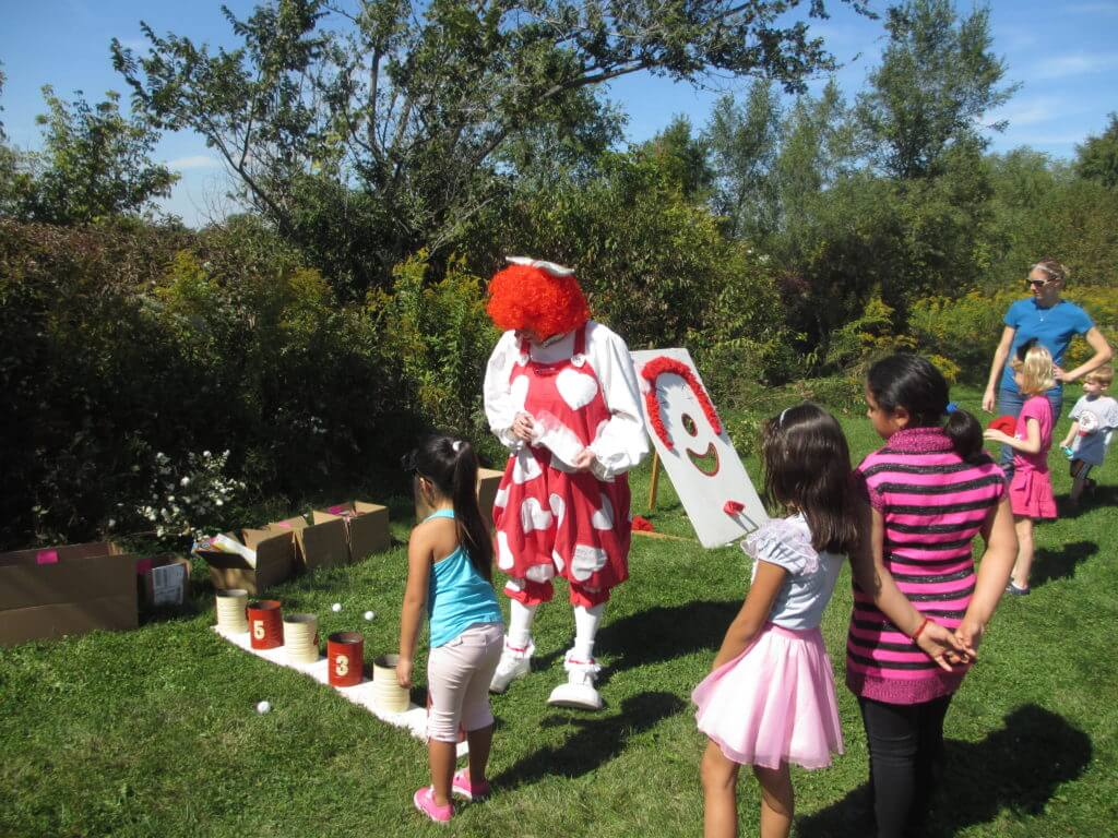 Clackers the Clown admiring Bozo's gift to childkind at the picnic.