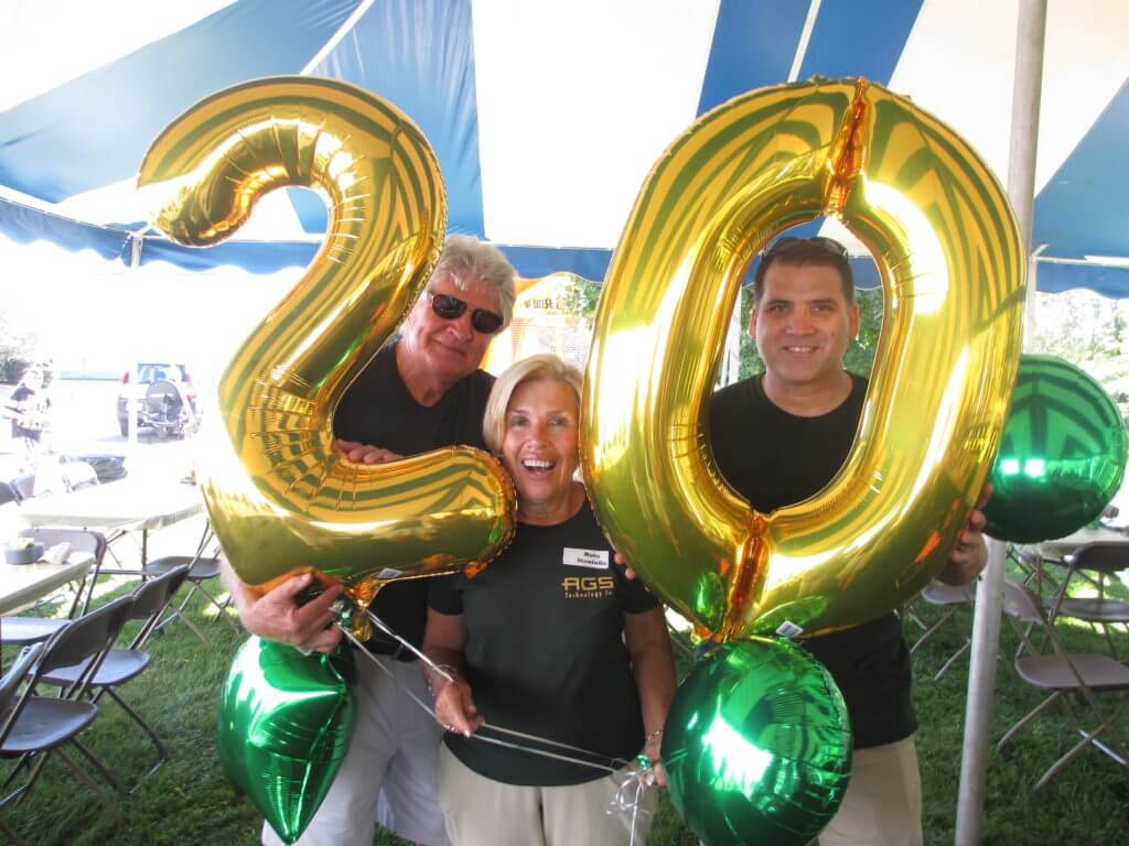 George Staniulis, Ruta Staniulis, and Chris Racelis celebrate 20 years.